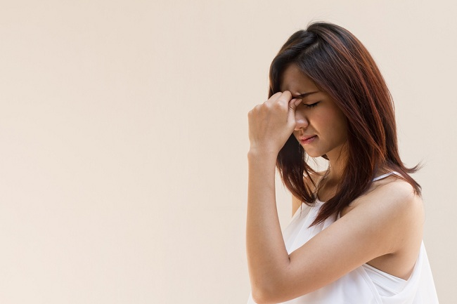 woman with headache, migraine, stress, insomnia, hangover in casual dress with blank space