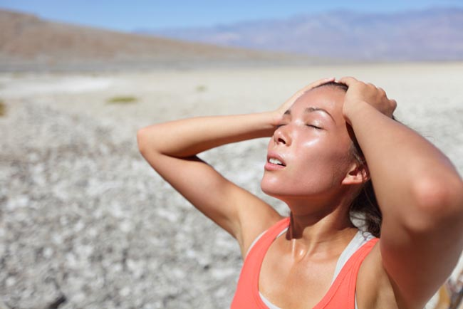 Desert woman thirsty dehydrated in Death Valley