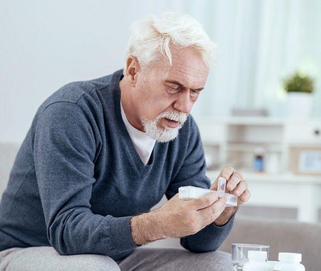 old man take medicine