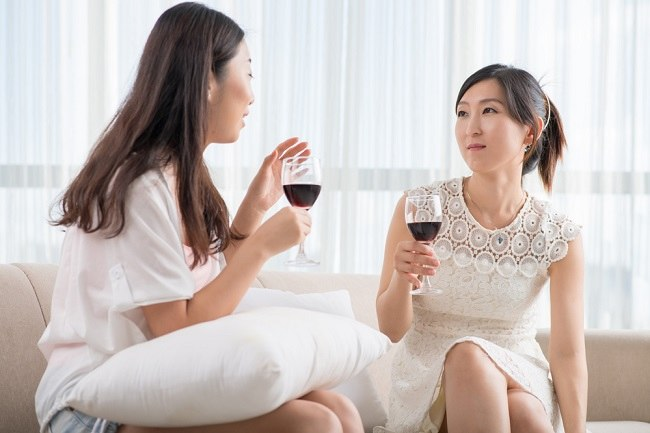 women drink wine