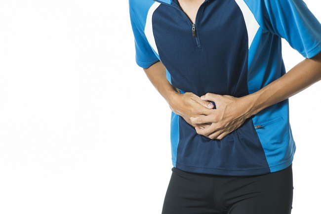 Man suffering from stomach pain