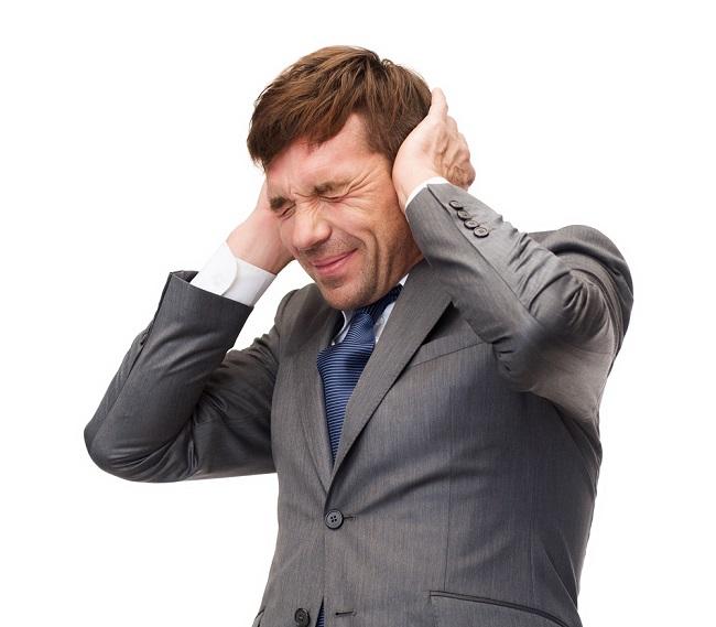stressed buisnessman or teacher closing ears