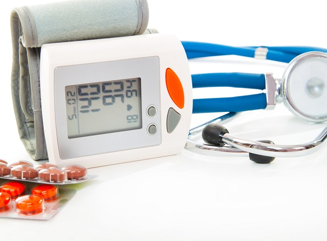 Stethoscope, blood pressure checker and pills, tablets isolated