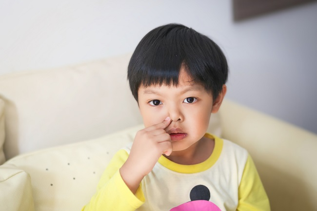 An,Asian,Boy,Blowing,His,Nose.