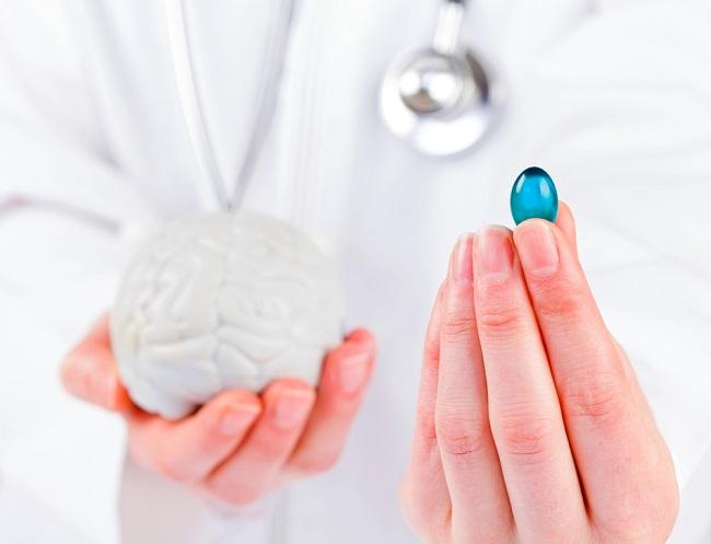 Closeup photo of blue gel capsule in doctor hand