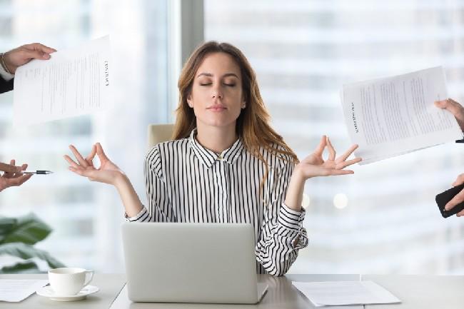 Calm,Female,Executive,Meditating,Taking,Break,At,Work,For,Mental