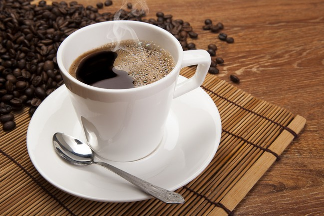 Cup,Of,Black,Coffee,And,Roasted,Coffe,Beans,Close,Up