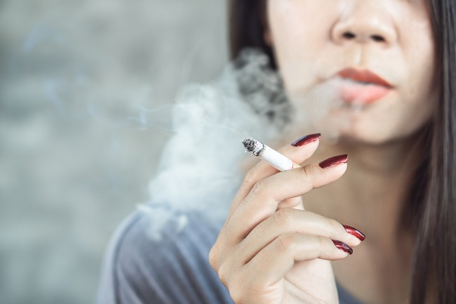 Closeup,Asian,Woman,Hand,Smoking,Cigarette,,unhealthy,Lifestyle,Concept