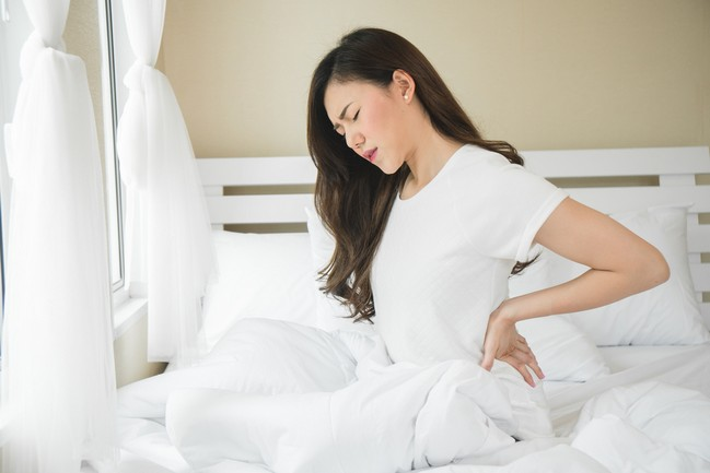 Asian,Woman,Have,A,Backache,In,Bedroom,Morning,Because,Sleep