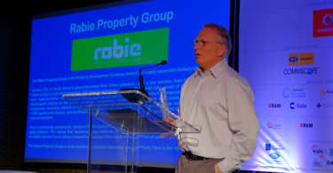 "Leon Cohen, MD of Rabie Property Group, addressing the annual conference of FTTH Council Africa at the Century City Conference Centre after receiving an award for the ""Most Tech Friendly Property Company"" in South Africa."