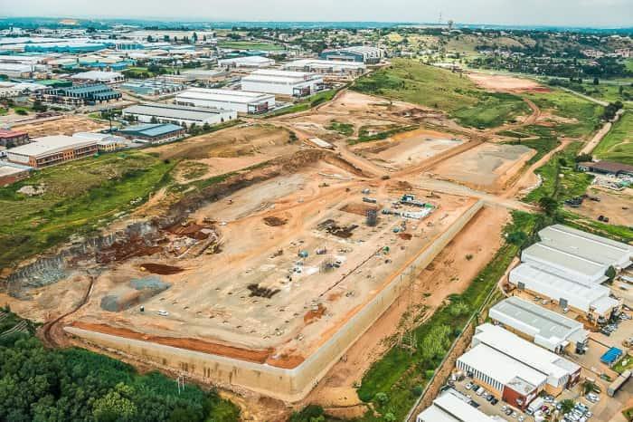 Komatsu development, Investec