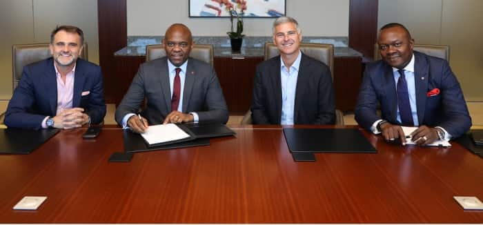 Tony Elumelu and Chris Nassetta at the signing.