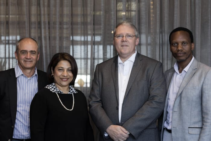Brian Wilkinson, outgoing CEO; Faieda Jacobs, Non-Executive Deputy Chair; Rudolf Pienaar, incoming Non-Executive Board Chair; and Seana Nkhahle, outgoing Non-Executive Chair.
