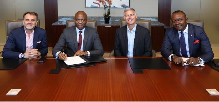 Tony Elumelu and Chris Nassetta at the signing.
