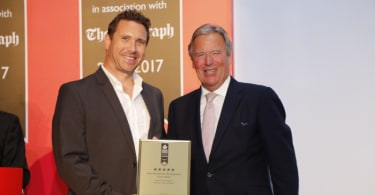 Claudius Combrinck, Executive Director, Sitari Property Sales, receiving the 5-Star Best Residential Development South Africa award on behalf of Sitari Country Estate from Chairman of the International Property Awards, the Earl of Liverpool, at the awards event held in Dubai.
