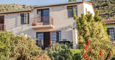 This 105m² three-bedroom double storey mountainside home in a quiet six-unit complex is for sale at R1.85 million.