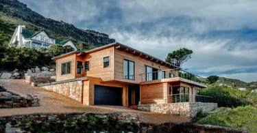 This stunning three bedroom house is one of only four homes in an exclusive, eco-friendly estate set on the Clovelly mountainside. On the market for R5.795 million, it has four bathrooms, a designer kitchen and never-ending views