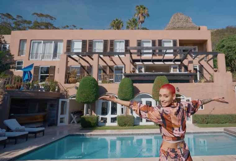 Contestant, Clanelle Burger in front of one of the most exclusive homes in SA, a 9-bed luxury villa with an asking price R120m.
