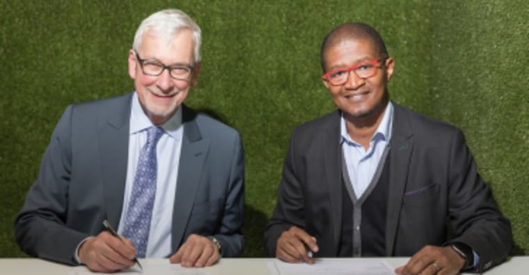 Signing a landmark Memorandum of Understanding (MoU) between the Royal Institution of Chartered Surveyors (RICS) and Green Building Council South Africa (GBCSA) is RICS President, John Hughes, and GBCSA's Non-Executive Deputy Chair, Nkosinathi Manzana, at the RICS Summit Africa underway in Sandton Central.