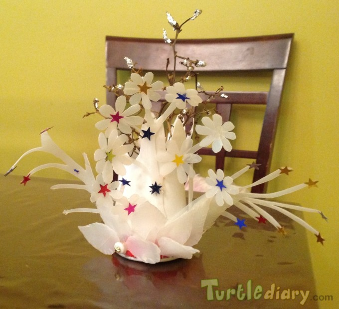 Recycled milk bottle and graped stems flower show piece - Earth Day Contest April 2015 Submission