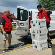 Greg and Iggy load van