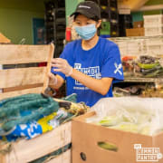 Volunteer UNpacking Produce