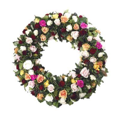 Farbenfroher Trauerkranz mit Blumen der Saison