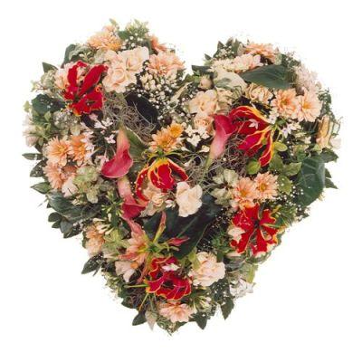 Trauerherz mit bunten Blumen der Saison
