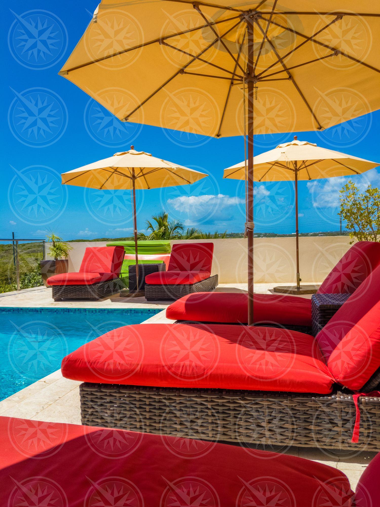 Lounge chairs around pool