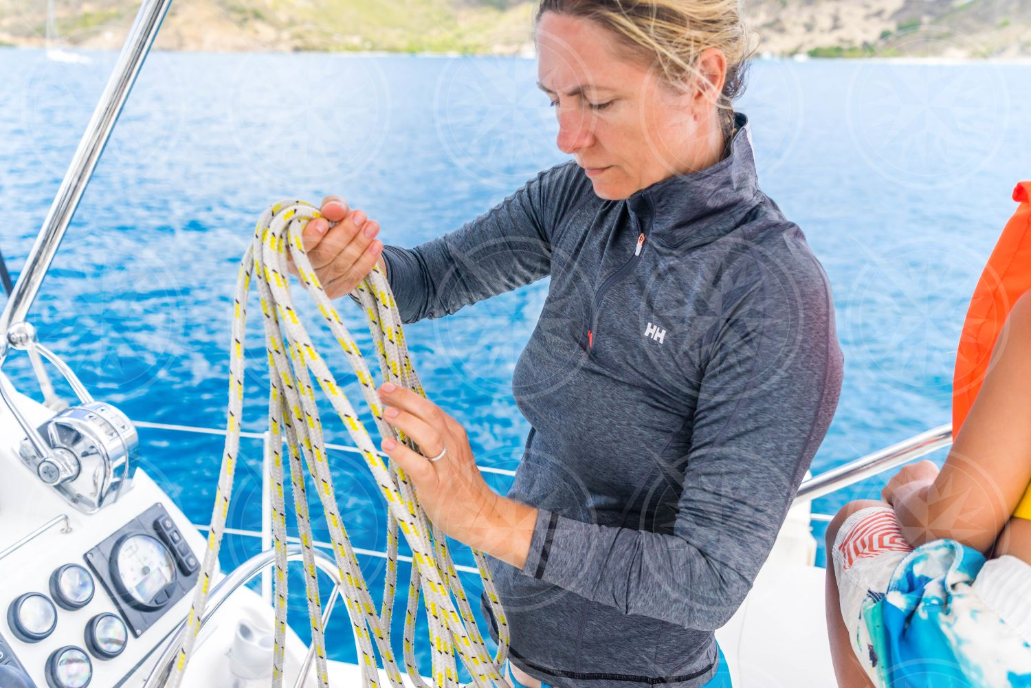 Woman sorting out lines on sailboat