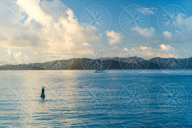 Boat sailing near the horizon
