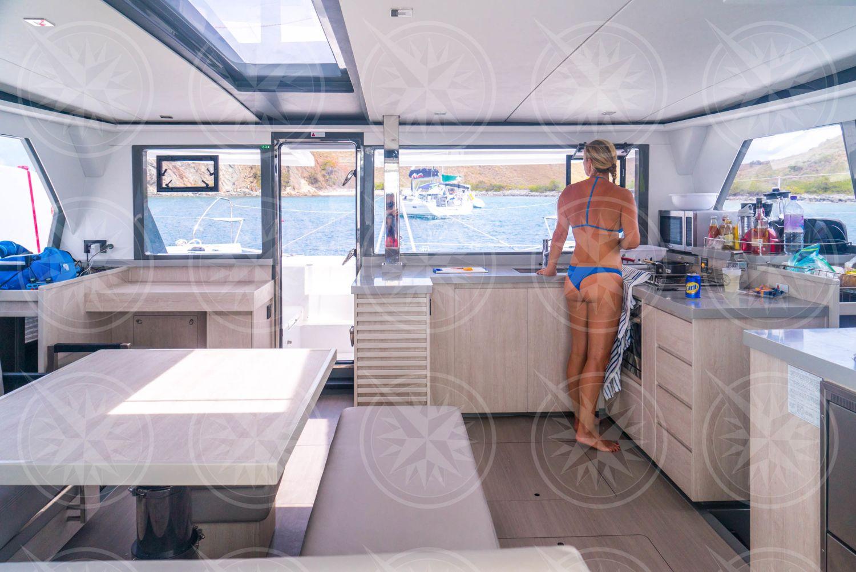 Woman in bikini in sailboat galley