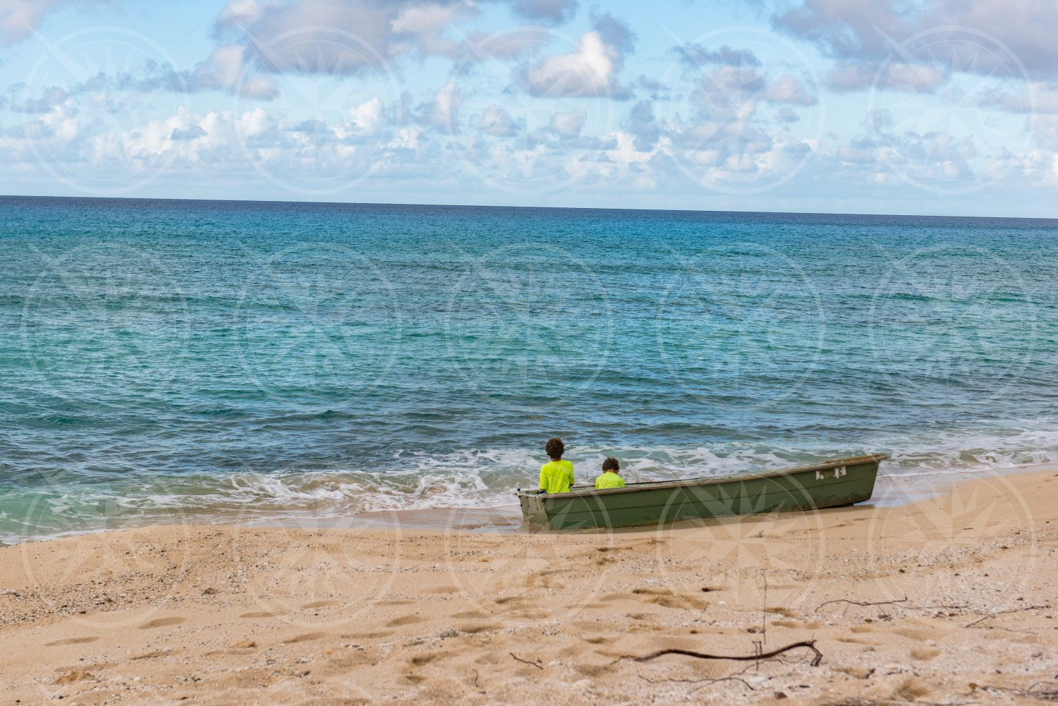 Young boys in a boat on a beach
