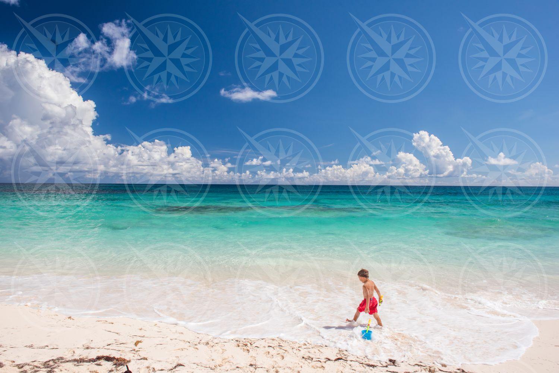 Boy on white sand beach