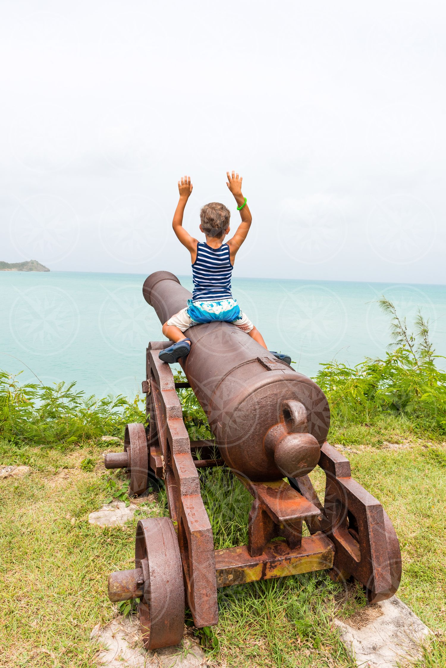 Boy on cannon at Fort James