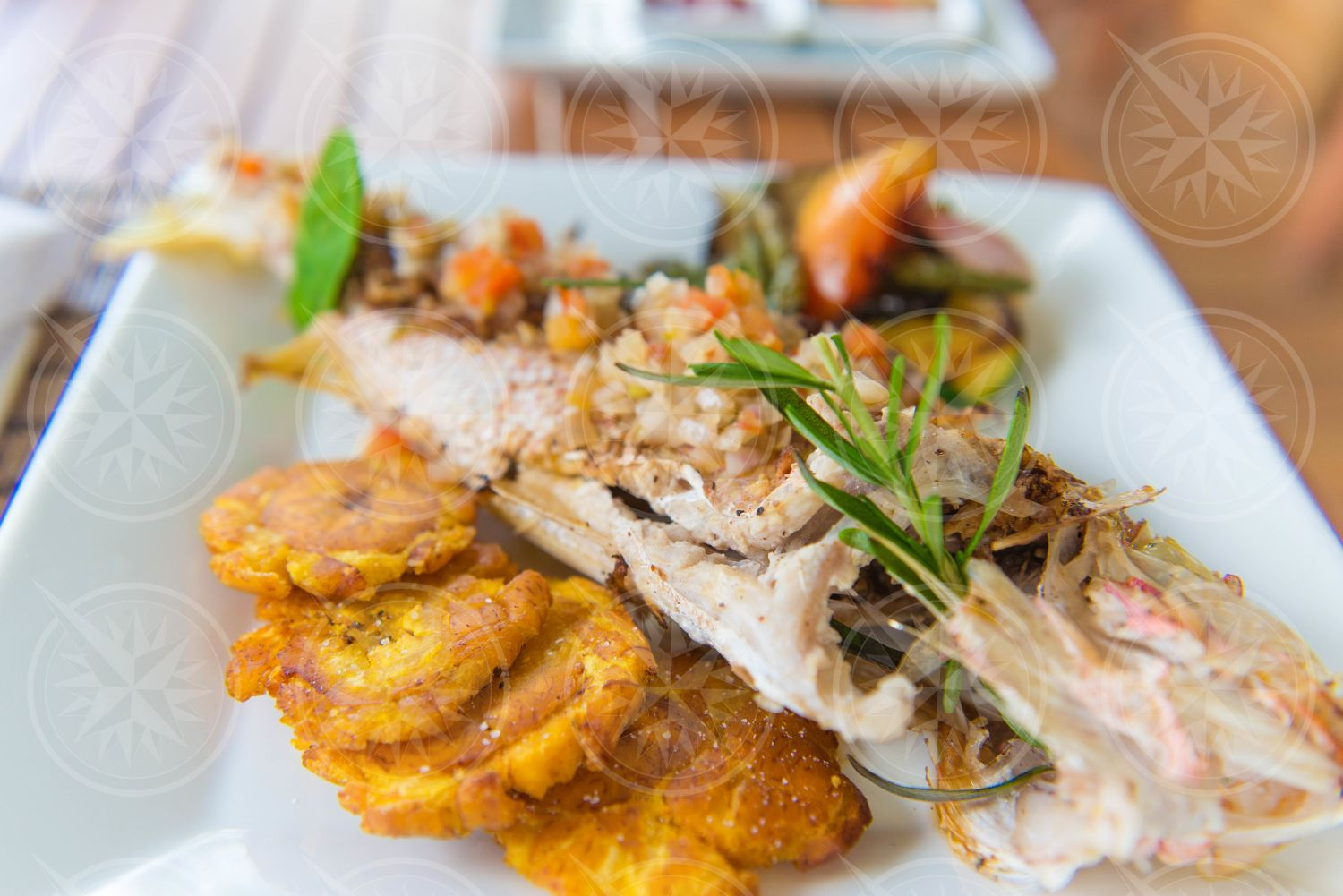 Fried fish with tostones entree