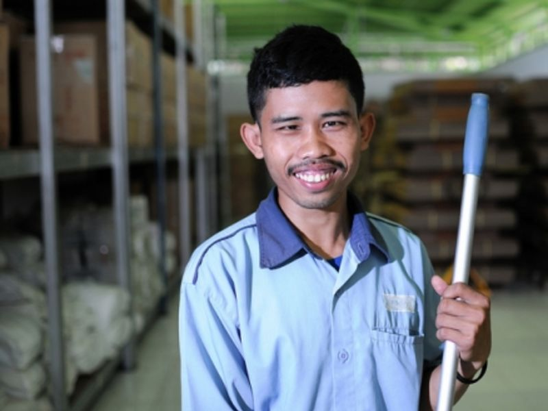A worker at an Indonesian clothing factory that provides employment opportunities for people with disabilities