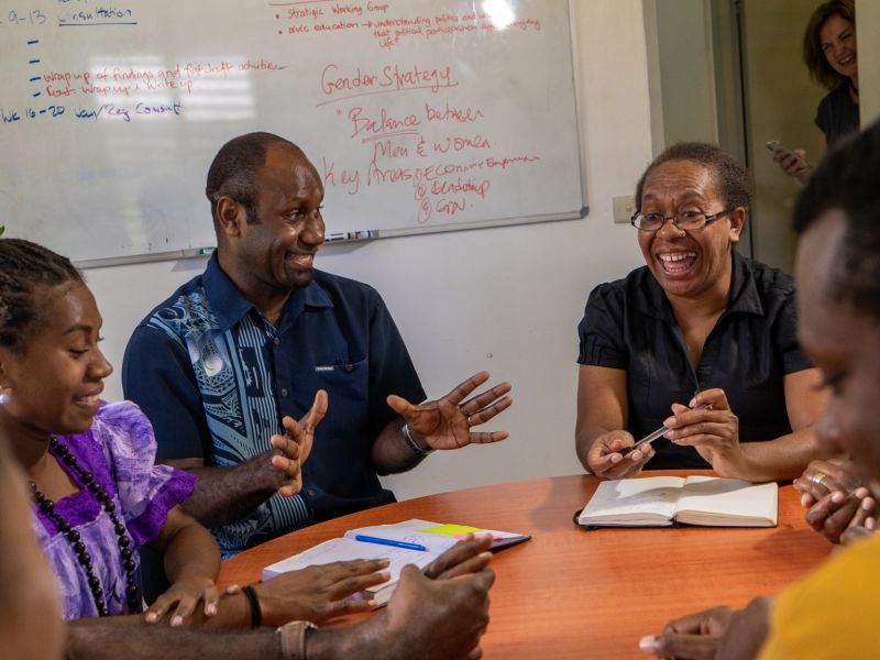 Vanuatu Skills Partnership Director, Fremden Yanhambath, in a planning meeting with the Director of the Department of Women's Affairs, Rothina Ilo Nako.