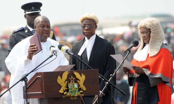 Ghana's President John Dramani Mahama, left, takes the oath of office in Accra in January 2013. Photograph: Pius Utomi Ekpei/AFP/Getty Images