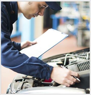 mechanic checking under hood during Audi Service