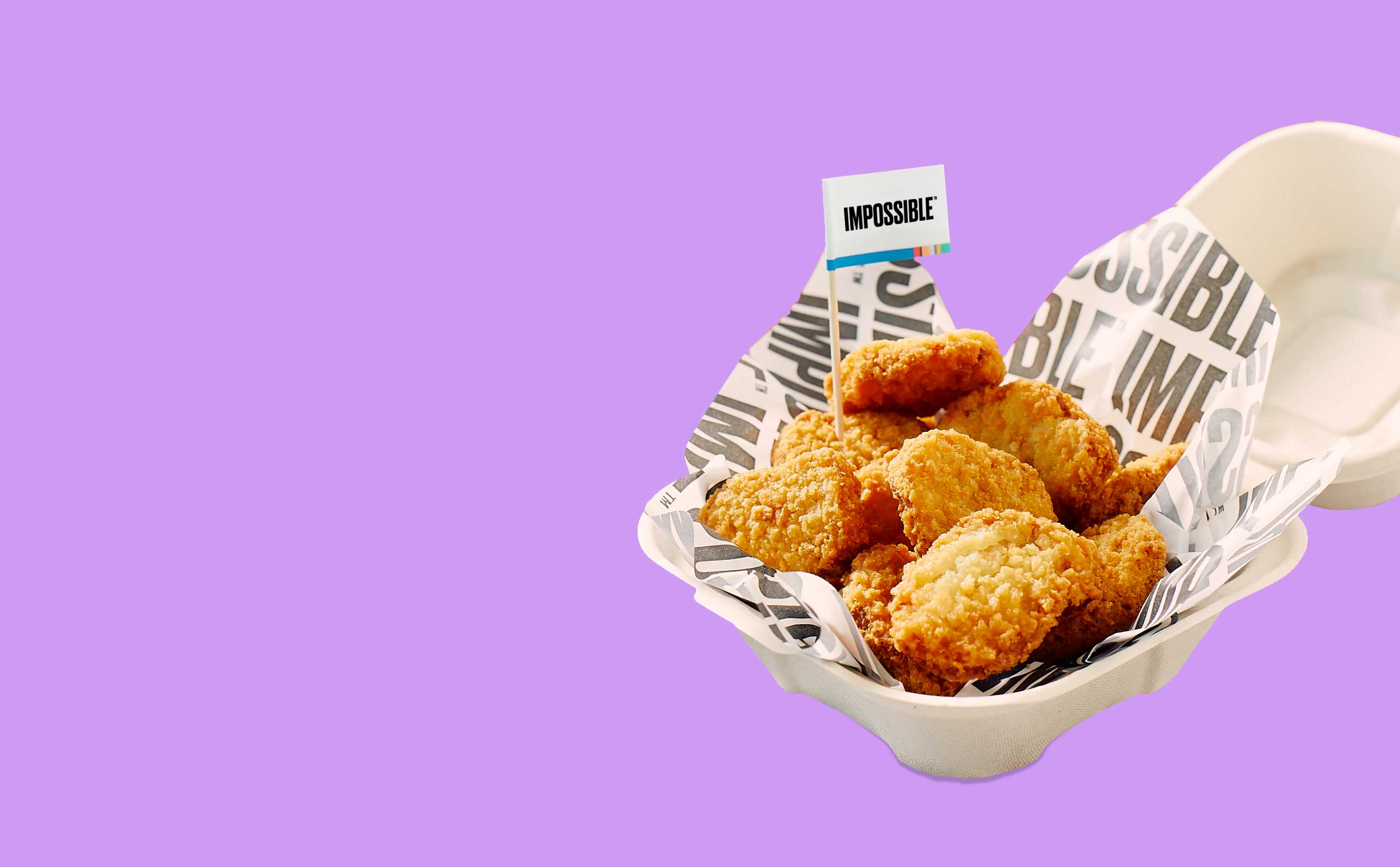 Impossible Chicken Nuggets with an Impossible toothpick flag in a takeout container on a purple background