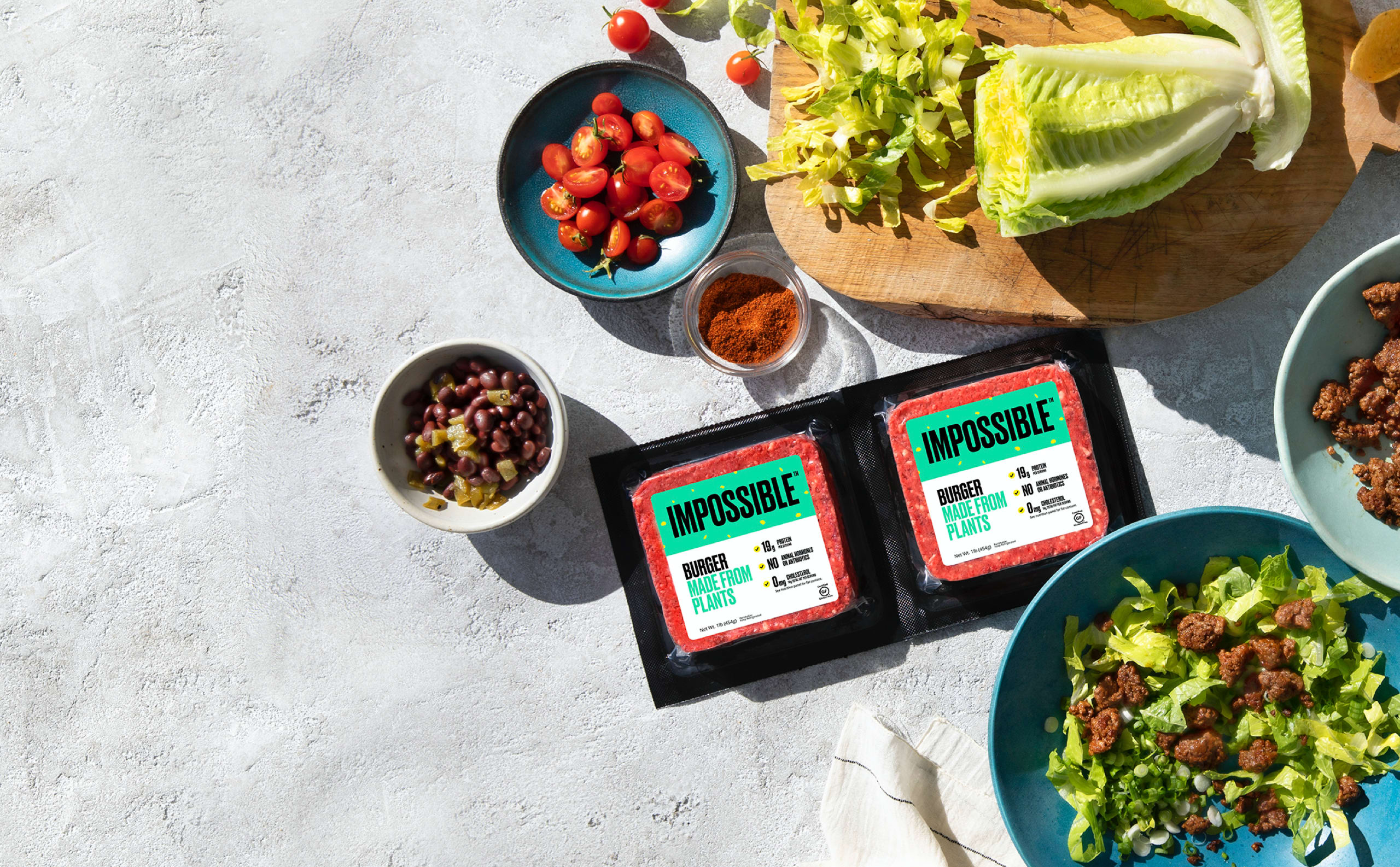 Impossible Foods with salad ingredients on chopping block