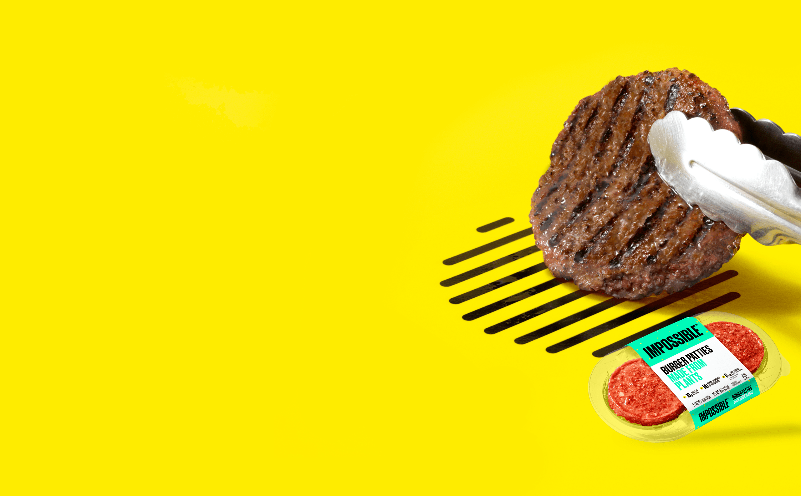 Impossible Burger patty will grill marks held with tongs next to raw Impossible Burger patties 2-pack grocery store packaging on yellow background