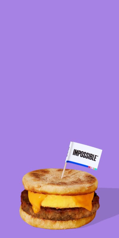 Impossible Sausage Breakfast Sandwich on purple background with Impossible Flag Plant Based Diet Breakfast