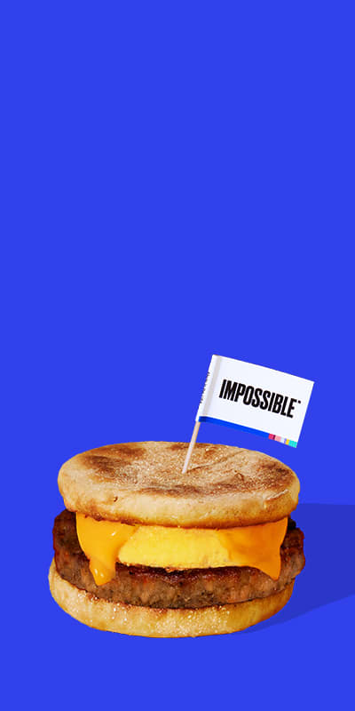 Impossible Foods Sausage hero image plant based sausage with blue background Plant Based Protein Foods