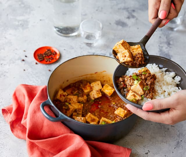 Steaming Impossible™ Mapo Tofu, made with Impossible™ Burger.