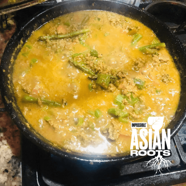 Impossible™ Veggie Curry Recipe using meat made from plants, asparagus, cauliflower, garlic, ginger, and warm Indian spices.
