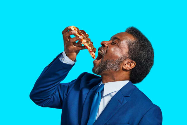 Man eating Impossible™ pizza