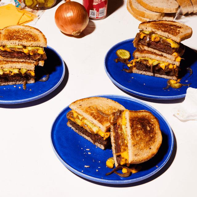 Recipe for Impossible Patty Melt made with Impossible Burger on blue plates