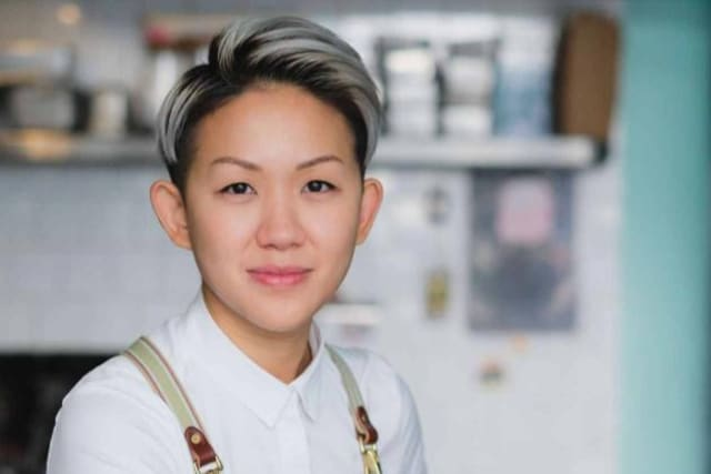 Headshot of Chef May Chow wearing an apron  in a restaurant